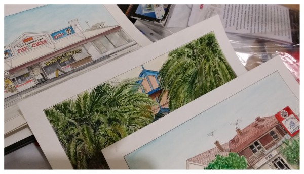 A series of watercolour paintings fanned over each other.