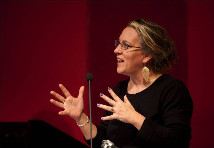 A photograph of Jo Verrent delivering a presentation.