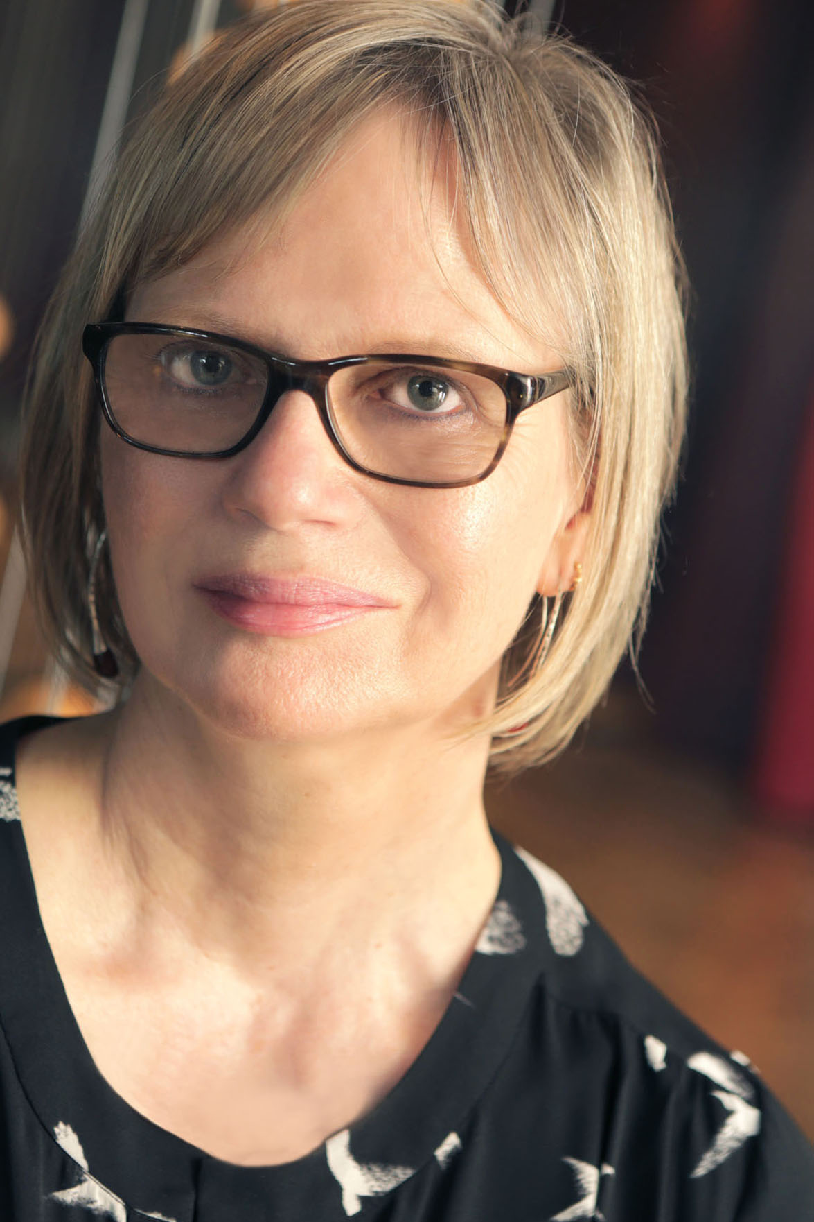 A photograph of Gaele Sobott, a blond haired woman wearing dark-rimmed glasses in modern style.