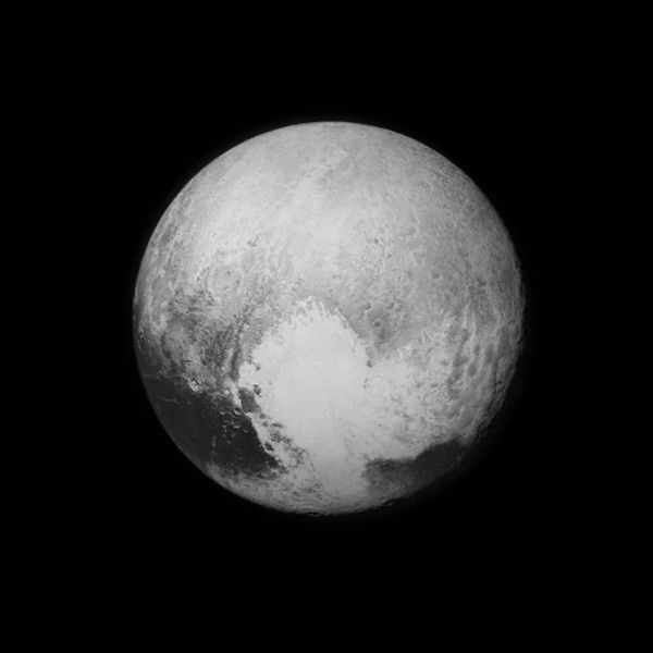 A photograph of the planet Pluto, a grey and white orb against pitch black space.