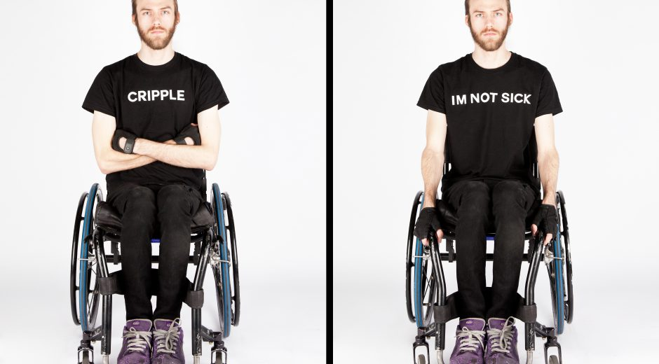 "Two photos of a young man who is a wheelchair user. He is wearing all black. I the first photo his arms are crossed on his lap. Printed in white on his t-shirt reads ""cripple"" in the second photo, his arms are down. This t-shirt reads ""I am not sick"""