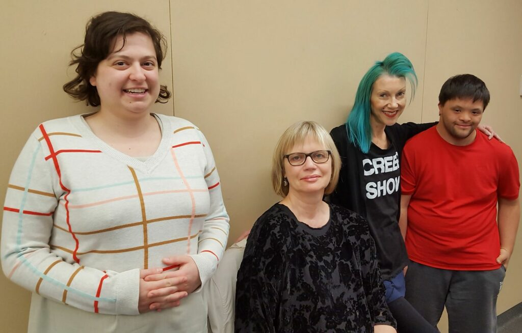 Four writers from writing me smiling at the camera. Left to right, Pony, Gaele, Alison and Josh.