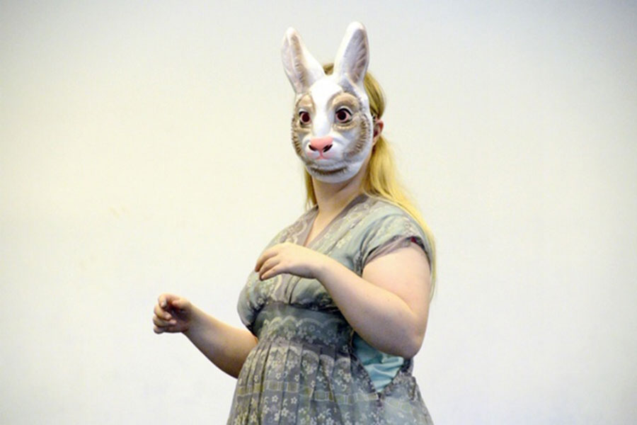 A female wearing a bunny mask